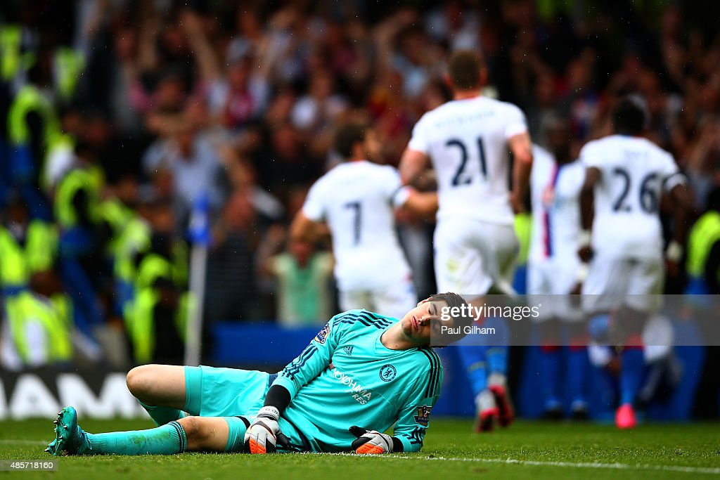 Thibaut Courtois of Chelsea reacts after conceding Crystal Palace's first goal during the Barclays Premier League match between Chelsea and Crystal Palace at Stamford Bridge on August 29, 2015 in London, England.