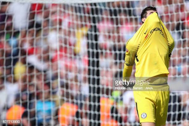Thibaut Courtois of Chelsea reacts after missing his penalty during the The FA Community Shield between Chelsea and Arsenal at Wembley Stadium on...