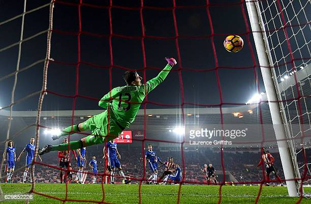 Thibaut Courtois of Chelsea saves a shot by Patrick van Aanholt of Sunderland during the Premier League match between Sunderland and Chelsea at...