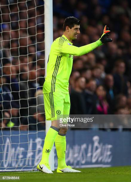 Thibaut Courtois of Chelsea signals during the Premier League match between Chelsea and Southampton at Stamford Bridge on April 25 2017 in London...