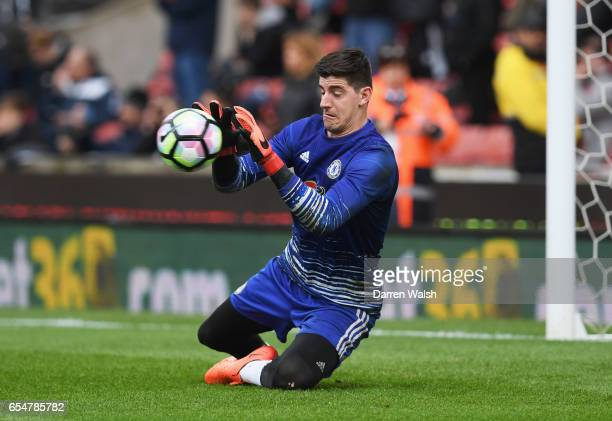 Thibaut Courtois of Chelsea warms up prior to the Premier League match between Stoke City and Chelsea at Bet365 Stadium on March 18 2017 in Stoke on...