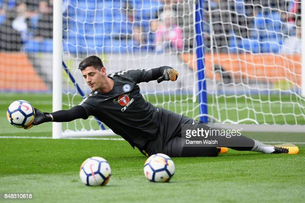 Thibaut Courtois of Chelsea warms up prior to the Premier League match between Chelsea and Arsenal at Stamford Bridge on September 17 2017 in London...