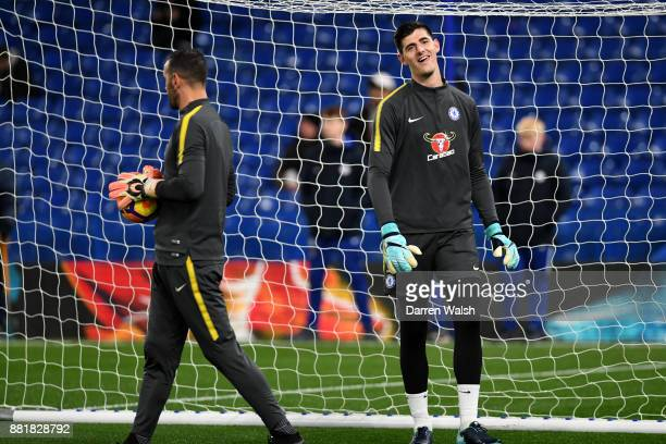 Thibaut Courtois of Chelsea warms up prior to the Premier League match between Chelsea and Swansea City at Stamford Bridge on November 29 2017 in...