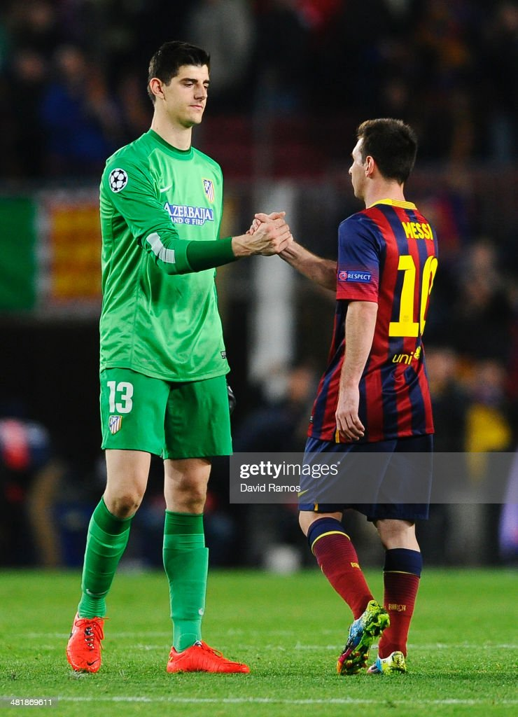 Thibaut Courtois of Club Atletico de Madrid shakes hands with Lionel Messi of Barcelona after the UEFA Champions League Quarter Final first leg match between FC Barcelona and Club Atletico de Madrid at Camp Nou on April 1, 2014 in Barcelona, Spain.