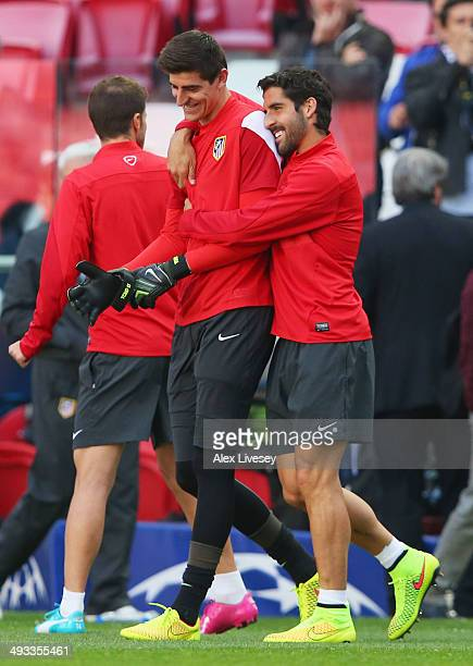 Thibaut Courtois of Club Atletico de Madrid shares a joke with Raul Garcia of Club Atletico de Madrid during a Club Atletico de Madrid training...