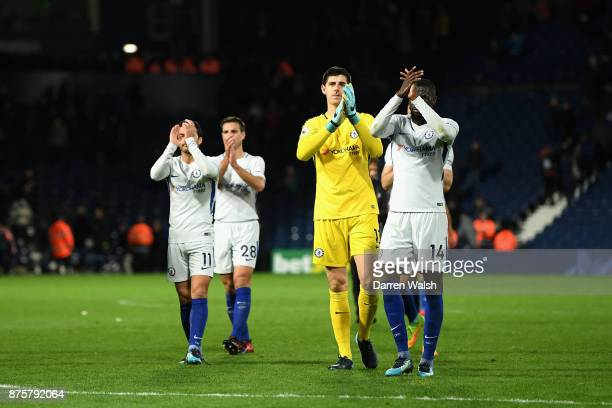 Thibaut Courtois Tiemoue Bakayoko Pedro and Cesar Azpilicueta of Chelsea shows appreciation to the fans after the Premier League match between West...