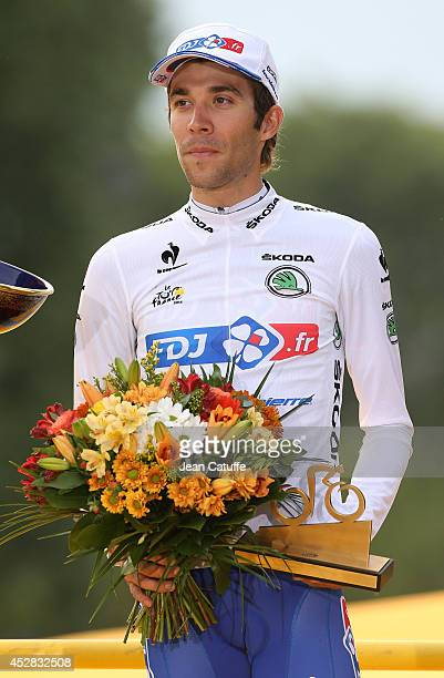 Thibaut Pinot of France and FDJfr receives the best young rider's white jersey on the podium after the twenty one and last stage of the 2014 Tour de...
