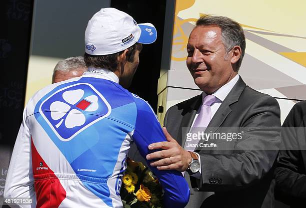 Thibaut Pinot of France and Team FDJ is congratulated by French Secretary of State for Sports Thierry Braillard following stage twentieth of the 2015...