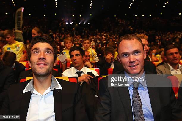 Thibaut Pinot of France chats to 2015 winner Chris Froome during the 2016 Tour de France Route Presentation at the Palais des Congrès de Paris on...