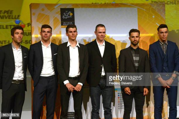 Thibaut Pinot Warren Barguil Chris Froome line up in front of the 2018 race route map during Le Tour de France 2018 Route Announcement at the Palais...