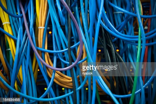 Thick Clusters of Overlapping Colorful Server Ethernet Network Cables Closeup