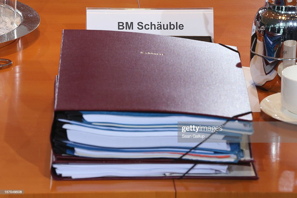 A thick folder of documents lies at the place of German Finance Minister Wolfgang Schaeuble prior to the weekly German government cabinet meeting on November 28, 2012 in Berlin, Germany. High on the morning's agenda was changes to the country's pension system.