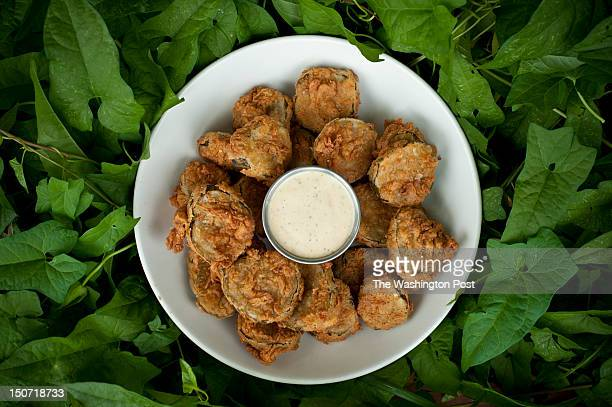 Thick slices of homemade pickles are used for the deepfried pickles served as an appetizer at the Mad Fox restaurant and brewery in Falls Church VA...