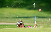 Thidapa Suwannapura of Thailand plays her third shot on the par 4 first hole during the final round of the 2015 Omega Dubai Ladies Masters on the...