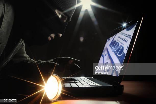 Thief accessing a laptop