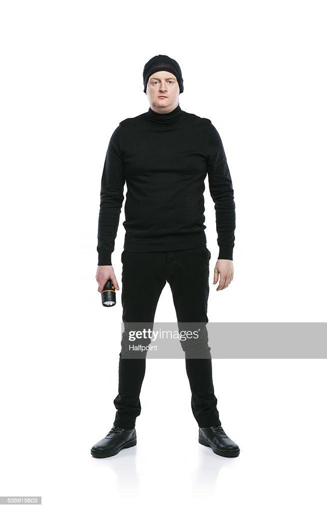 Ladrão na máscara negra : Foto de stock
