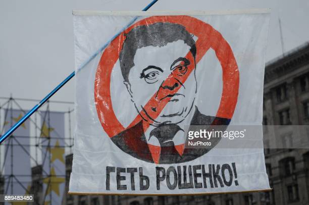 Thief Poroshenko is seen written on a banner during a rally calling for his impeachment in Kiev Ukraine on December 10 2017