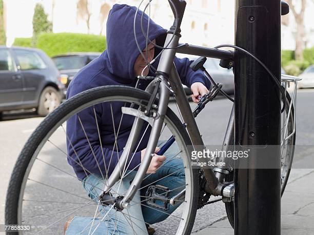 A thief stealing a bike