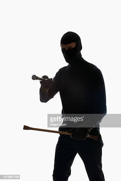 A thief wearing a balaclava