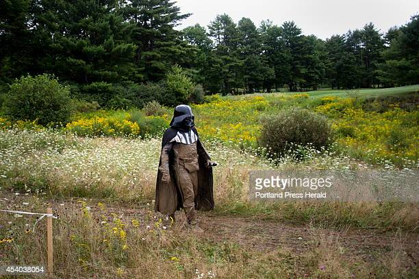 Thien Than Su Chet of upstate New York dressed head to toe as Star Wars character Darth Vader walks the Tough Mudder obstacle course after crawling...