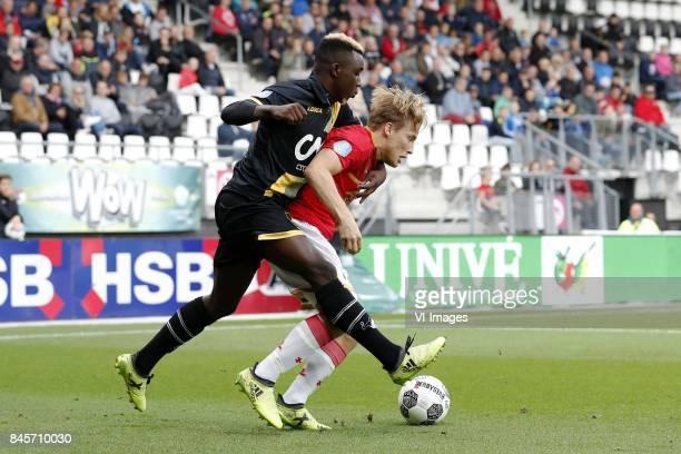 Thierry Ambrose of NAC Breda Jonas Svensson of AZ during the Dutch Eredivisie match between AZ Alkmaar and NAC Breda at AFAS stadium on September 10...