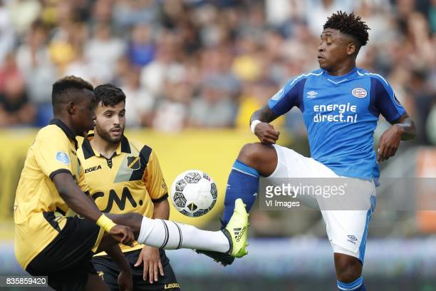 Thierry Ambrose of NAC Breda Mounir El Allouchi of NAC Breda Steven Bergwijn of PSV during the Dutch Eredivisie match between NAC Breda and PSV...