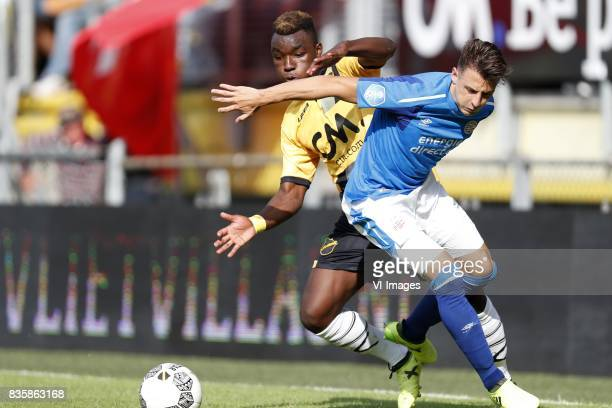 Thierry Ambrose of NAC Breda Santiago Arias of PSV during the Dutch Eredivisie match between NAC Breda and PSV Eindhoven at the Rat Verlegh stadium...
