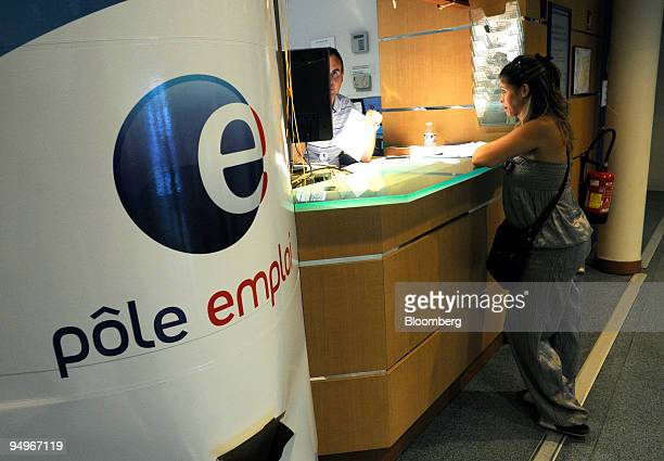 Thierry Berbigier left assists a jobseeker at a Pole Emploi unemployment office in Marseille France on Wednesday Aug 19 2009 French Employment...