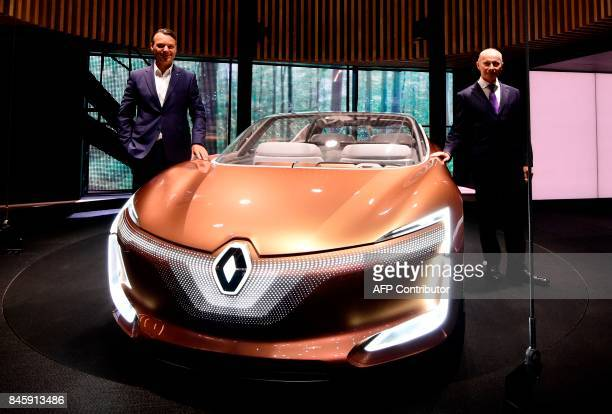 Thierry Bollore deputy director of Competitiveness of French carmaker Renault andRenauld Senior VicePresident for Corporate Design Laurens van den...