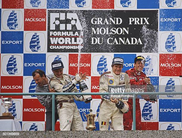 Thierry Boutsen of Belgium and Riccardo Patrese of Italy drivers of the Canon Williams Team Williams FW12C Renault V10 celebrate their first and...