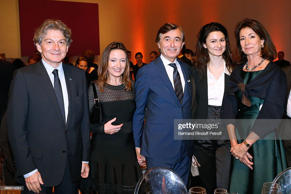 Thierry Breton (L), his wife Valerie Breton (R), their daughter (2nd R), Philippe Douste-Blazy (3rd L) and Marie Laure Bec (2nd L) attend the 'Fondation Claude Pompidou' : Charity Party at Fondation Louis Vuitton on December 16, 2014 in Paris, France.