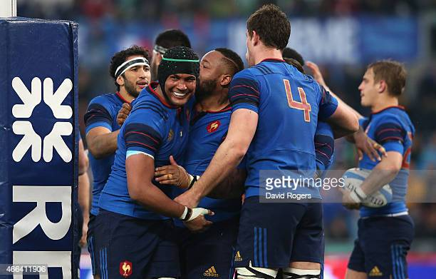 Thierry Dusatoir the France captain congratulates team mate Mathieu Bastareaud after his try during the Six Nations match between Italy and France at...
