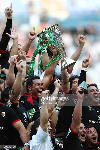 Thierry Dusautoir and members of the Toulouse team celebrate with the trophy after winning the Heineken Cup Final at Stade France on May 22 2010 in...