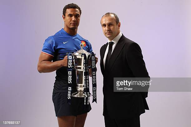 Thierry Dusautoir of France and Head Coach Philippe SaintAndre of France pose with the RBS Six Nations trophy during the RBS Six Nations Launch at...