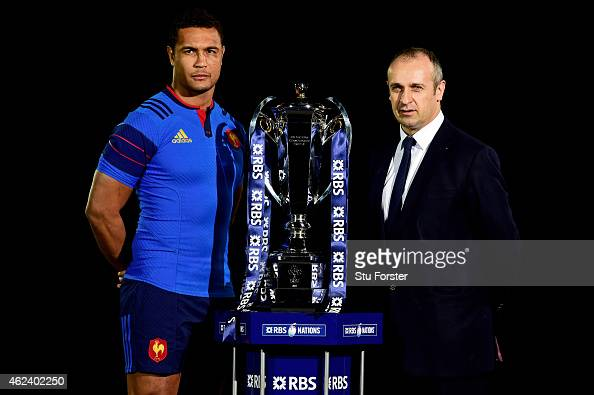 Thierry Dusautoir of France and Philippe Saint Andre pose with the trophy during the launch of the 2015 RBS Six Nations at the Hurlingham club on...