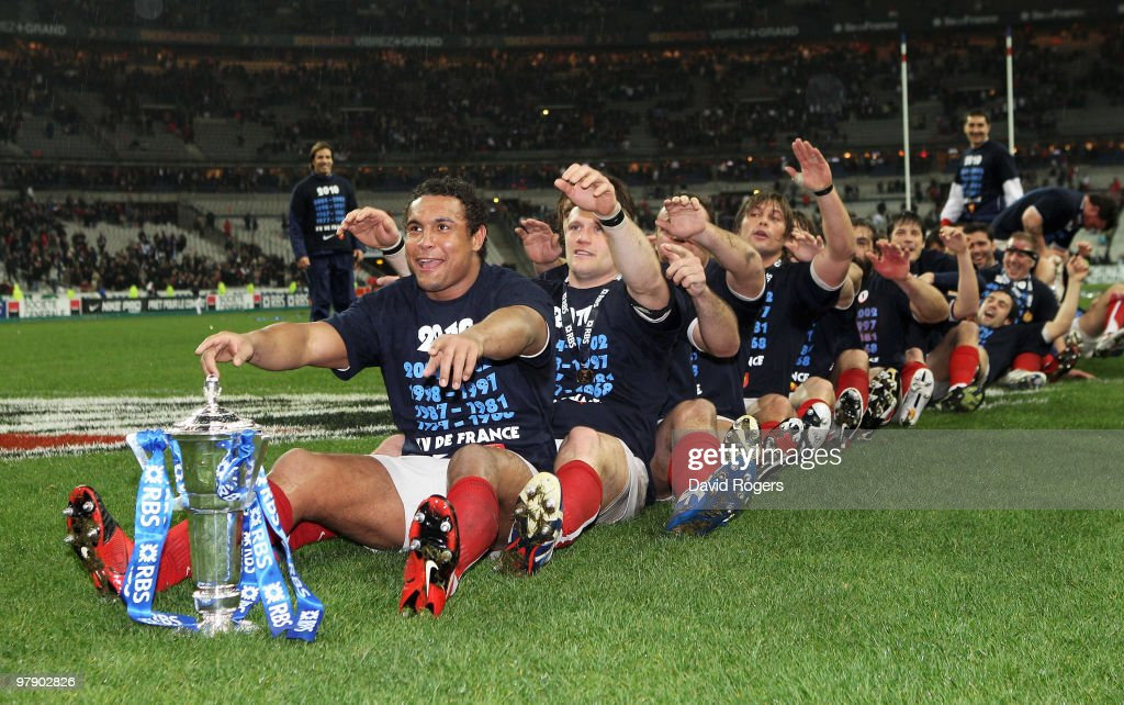 Thierry Dusautoir (L) of France celebrates with his team mates after France completed the Grad Slam during the RBS Six Nations Championship match between France and England at the Stade de France on March 20, 2010 in Paris, France.