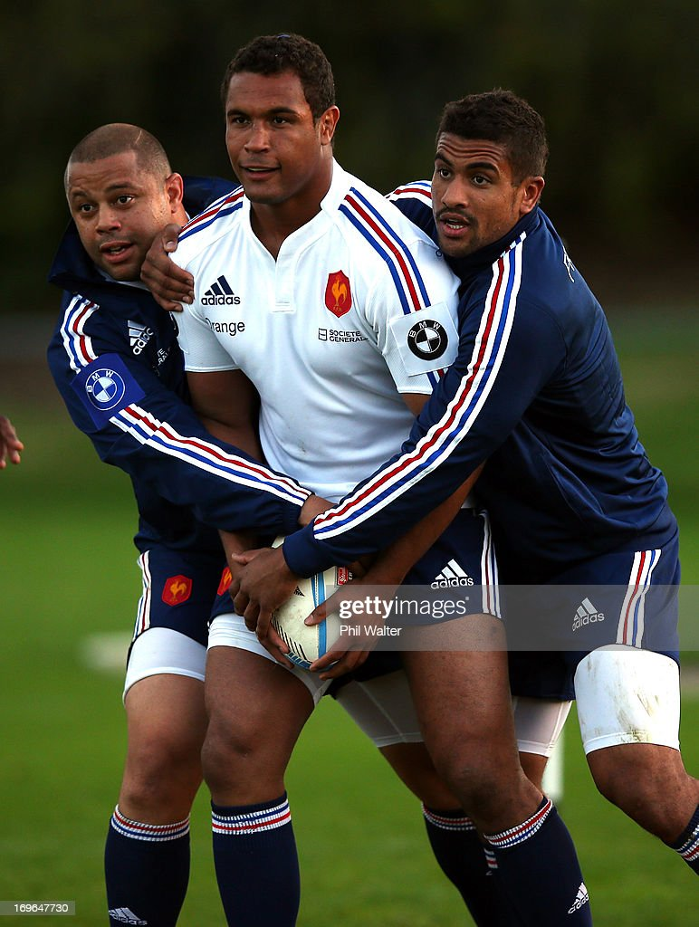 <a gi-track='captionPersonalityLinkClicked' href=/galleries/search?phrase=Thierry+Dusautoir&family=editorial&specificpeople=544025 ng-click='$event.stopPropagation()'>Thierry Dusautoir</a> of France is tackled during a France rugby training session at Onewa Domain on May 30, 2013 in Takapuna, New Zealand.