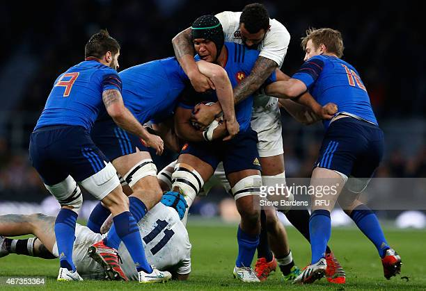 Thierry Dusautoir of France is wrapped up by Jack Nowell of England and Courtney Lawes of England during the RBS Six Nations match between England...