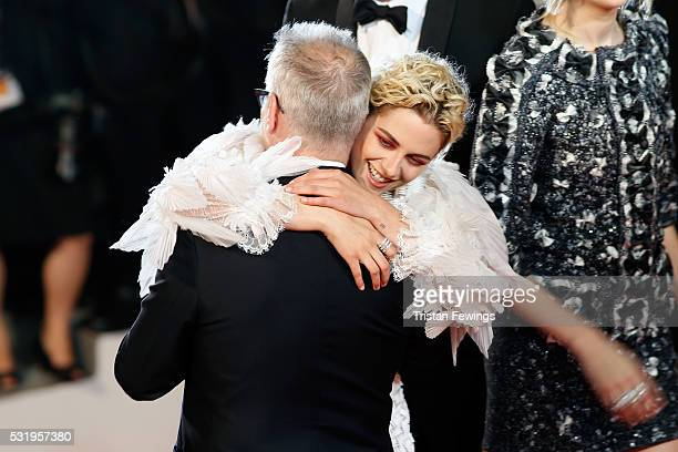 Thierry Fremaux welcomes actress Kristen Stewart at the 'Personal Shopper' premiere during the 69th annual Cannes Film Festival at the Palais des...
