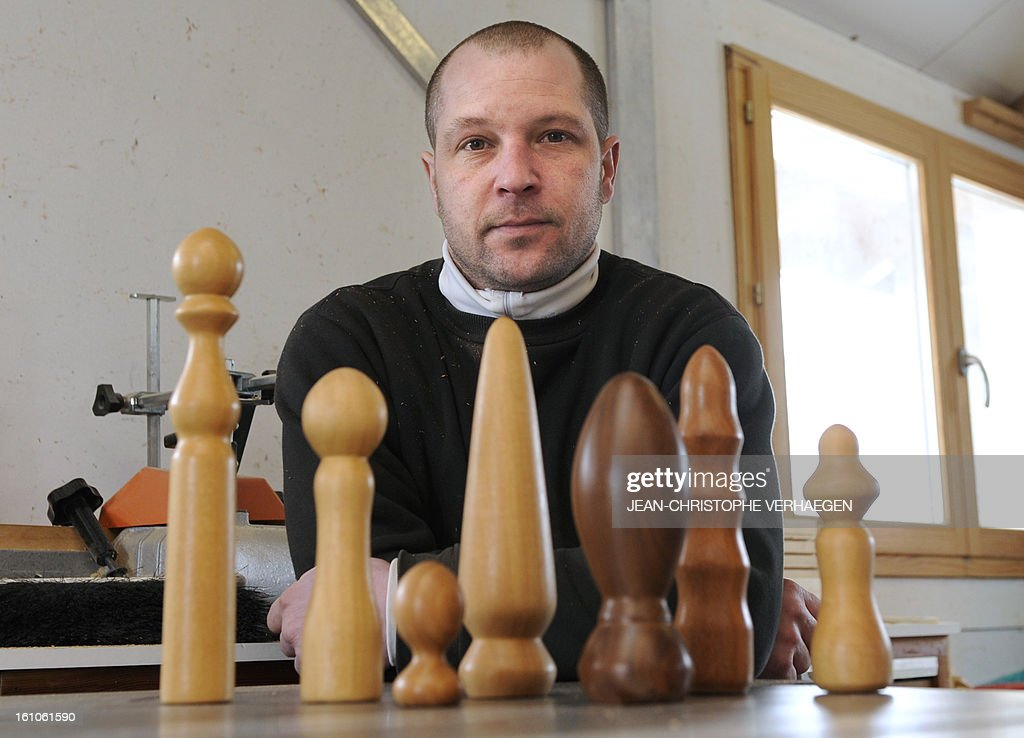 Thierry Germain, a French carpenter, poses with wooden dildos in his studio, on February 8, 2013 in Basse-sur-le-Rupt, eastern France. Germain manufactures and sells wooden sex toys.