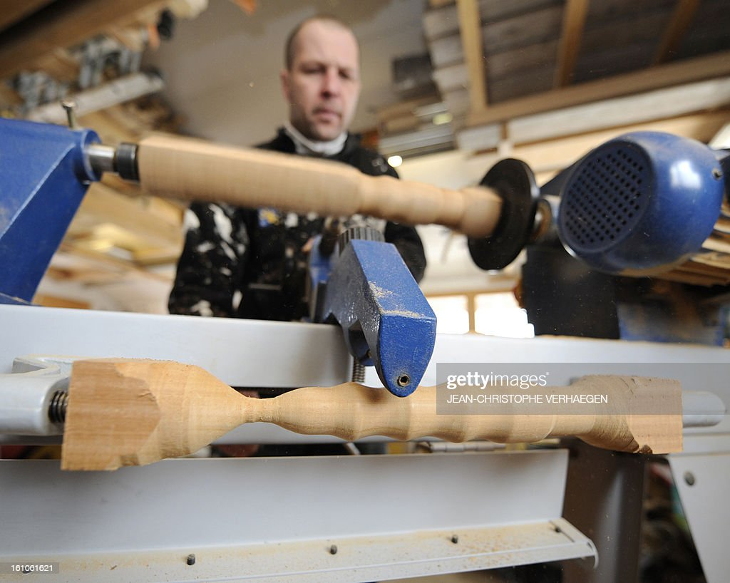 Thierry Germain, a French carpenter, works on a wooden dildo in his studio, on February 8, 2013 in Basse-sur-le-Rupt, eastern France. Germain manufactures and sells wooden sex toys.