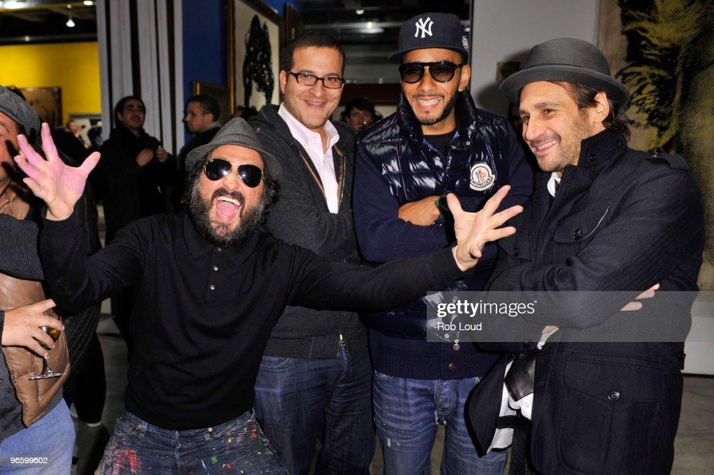 Thierry Guetta, aka Mr. Brainwash, Doug Davis, Swizz Beatz, and Todd Moscowitz attend the Mr. Brainwash solo exhibition opening on February 11, 2010 in New York City.