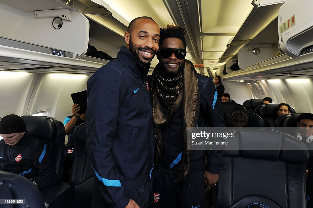 <a gi-track='captionPersonalityLinkClicked' href=/galleries/search?phrase=Thierry+Henry&family=editorial&specificpeople=167275 ng-click='$event.stopPropagation()'>Thierry Henry</a> (L) and <a gi-track='captionPersonalityLinkClicked' href=/galleries/search?phrase=Alex+Song&family=editorial&specificpeople=652067 ng-click='$event.stopPropagation()'>Alex Song</a> of Arsenal pose together on the plane at Luton Airport as they travel to Milan ahead of their UEFA Champions League Group match against AC Milan at San Siro Stadium on February 14, 2012 in Luton, England.
