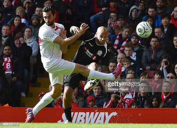 Thierry Henry and Alvaro Arbeloa compete during the Liverpool All Star Charity Match at Anfield on March 29 2015 in Liverpool England
