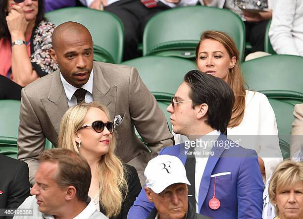 Thierry Henry and Andrea Rajacic attend day 13 of the Wimbledon Tennis Championships at Wimbledon on July 12 2015 in London England