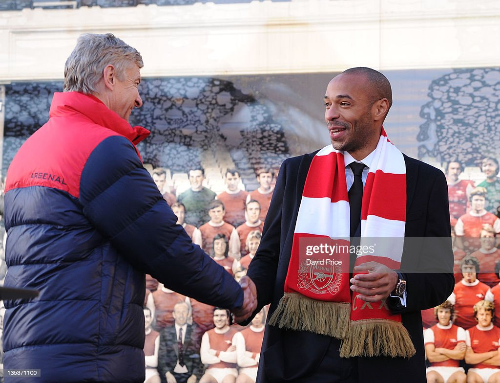 <a gi-track='captionPersonalityLinkClicked' href=/galleries/search?phrase=Thierry+Henry&family=editorial&specificpeople=167275 ng-click='$event.stopPropagation()'>Thierry Henry</a> and <a gi-track='captionPersonalityLinkClicked' href=/galleries/search?phrase=Arsene+Wenger&family=editorial&specificpeople=171184 ng-click='$event.stopPropagation()'>Arsene Wenger</a> the Arsenal Manager at the Statue unveilling at Emirates Stadium, one of three iconic statues to be placed at the Emirates Stadium home of Arsenal Football Club, on December 9, 2011 in London, England.
