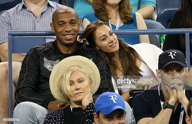 Thierry Henry and his girlfriend Andrea Rajacic attend the match between Roger Federer of Switzerland and Gael Monfils of France during Day 11 of the...