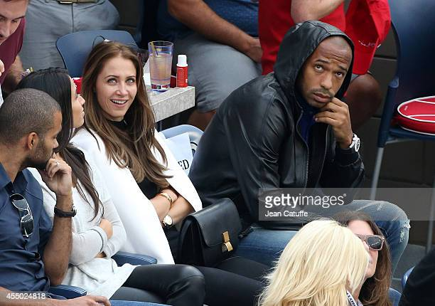 Thierry Henry and his girlfriend Andrea Rajacic attend the men's final on Day 15 of the 2014 US Open at USTA Billie Jean King National Tennis Center...