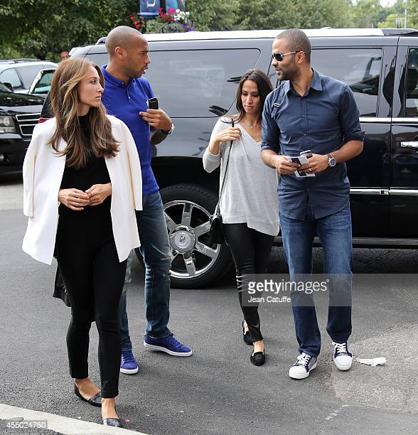 Thierry Henry and his girlfriend Andrea Rajacic Tony Parker and his wife Axelle Parker attend the men's final on Day 15 of the 2014 US Open at USTA...