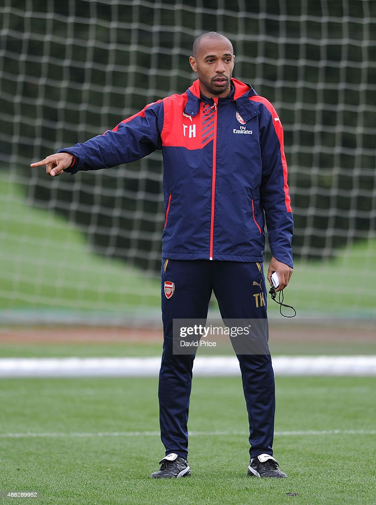 <a gi-track='captionPersonalityLinkClicked' href=/galleries/search?phrase=Thierry+Henry&family=editorial&specificpeople=167275 ng-click='$event.stopPropagation()'>Thierry Henry</a> assisting with the coaching session during the U19 training session at London Colney on September 15, 2015 in St Albans, England.